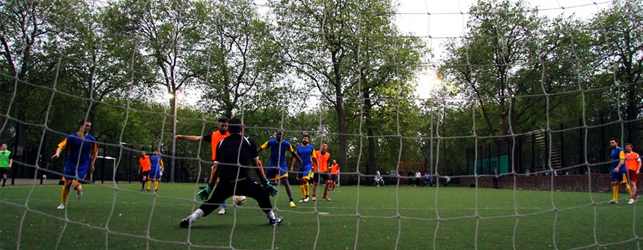 Play competitive football game in North London Highbury and Islington