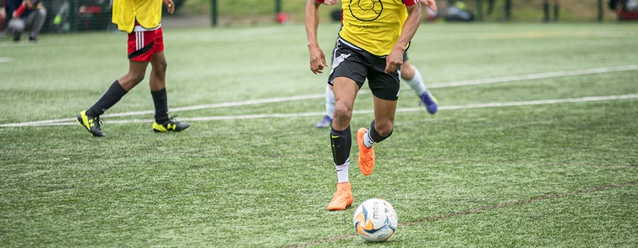 Play competitive football league in London